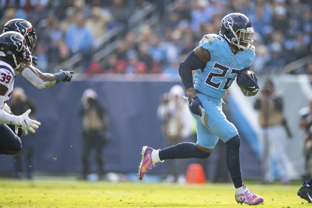 Derrick Henry of the Tennessee Titans carries the ball against the Houston Texans during the second quarter at Nissan Stadium on December 15, 2019 in Nashville, Tennessee.