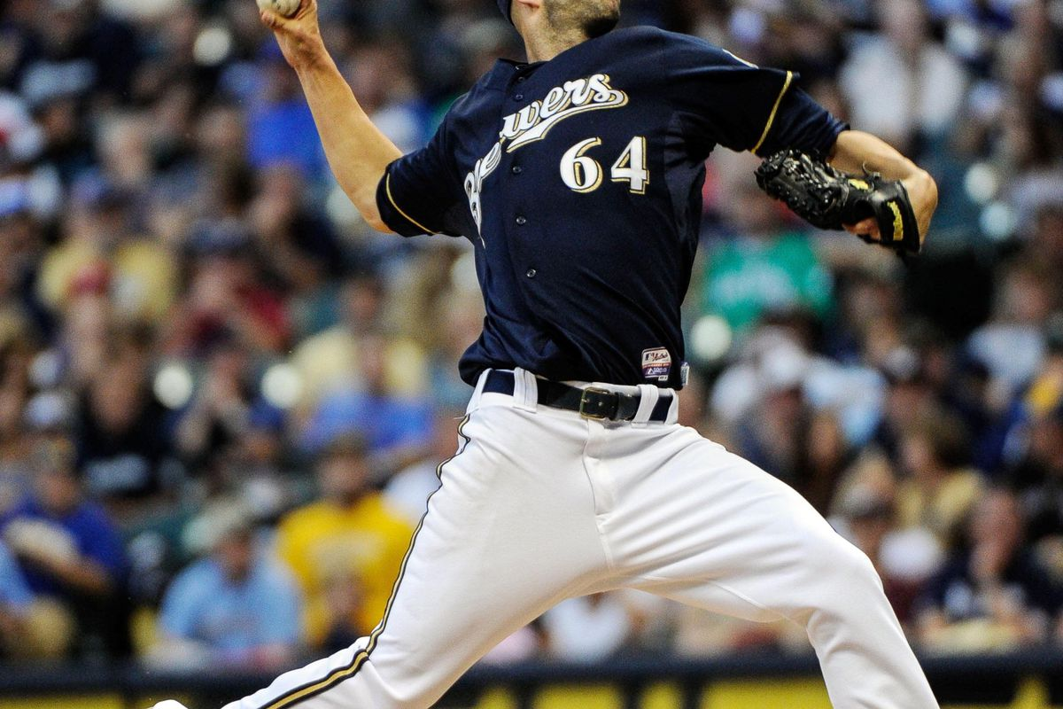 Aug 18, 2012; Milwaukee, WI, USA;  Milwaukee Brewers pitcher Mike Fiers (64) pitches against the Philadelphia Phillies at Miller Park.  Mandatory Credit: Benny Sieu-US PRESSWIRE