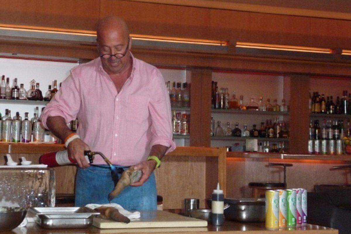 Andrew Zimmern torching a geoduck clam at Cut's sidebar, Thursday.