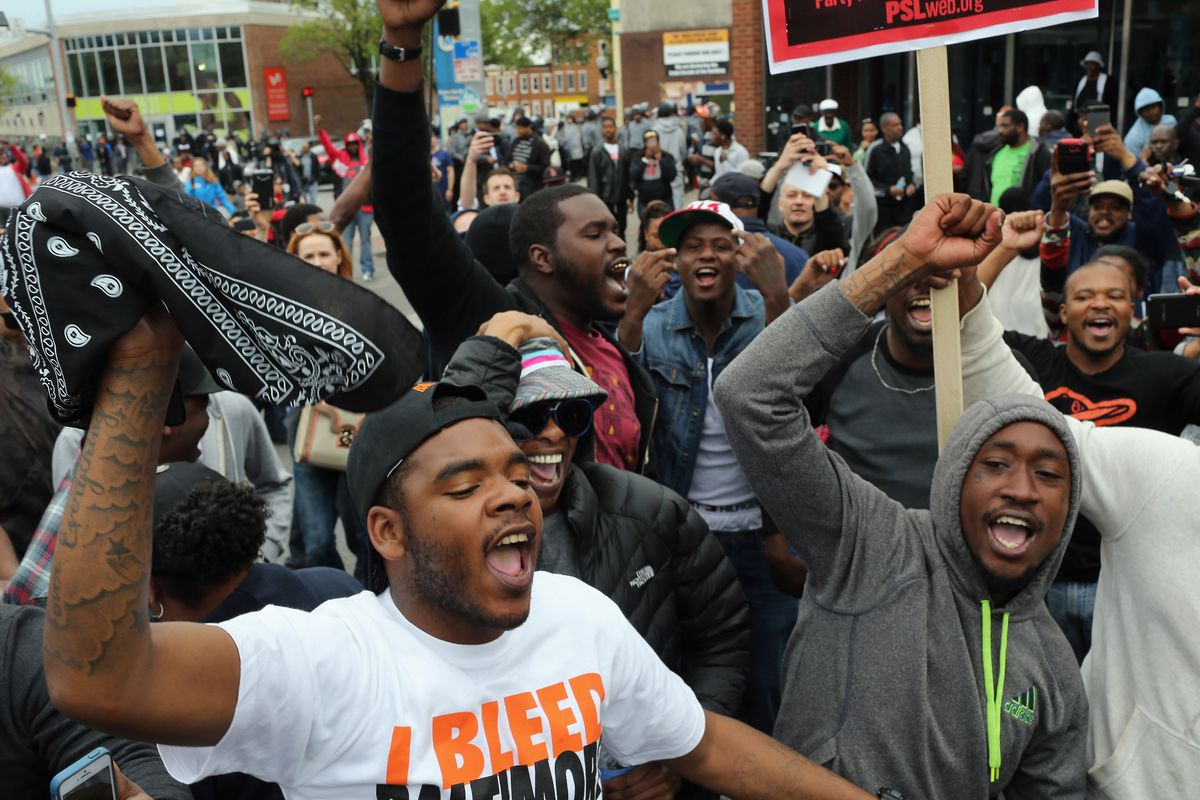 People react after Baltimore authorities released a report on the death of Freddie Gray on May 1, 2015.