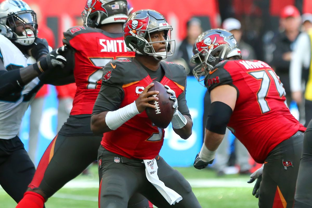 Jameis Winston of the Bucs looks for an open receiver during the game between the Carolina Panthers and the Tampa Bay Buccaneers on October 13th, 2019 at Tottenham Hotspur Stadium in London, England.