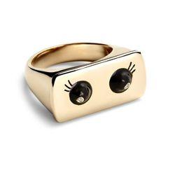 "Alison Lou <a href=""http://www.stoneandstrand.com/rings/alison-lou-black-enamel-eyes-ring"">Black Enamel Eyes Ring</a>, $2,500"