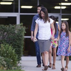 Emigh Lo leads her family, Sophi Lo, 9, Olivia Lo, 11, and husband Raymond Lo, out of an LDS meetinghouse in Sandy  on Thursday, June 8, 2017, after an interfaith gathering to comfort the community following Tuesday's deadly shooting.