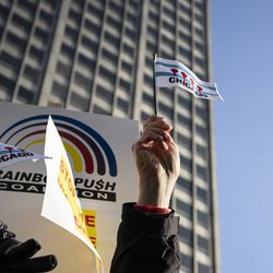 Chicago flags with bullet holes instead of red stars were featured during an anti-violence protest Thursday along the Magnificent Mile.