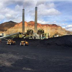 Coal from various sources is mixed in the foreground for use at the Huntington power plant in Huntington in this panoramic view, Tuesday, March 24, 2015.