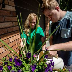 Jennie Dopp, left and son Jackson Dopp water plants outside of their home in Layton on Friday, June 4, 2021. Jackson Dopp has autism and had been waitlisted for services for people with disabilities for many years, but the end's nowhere in sight.