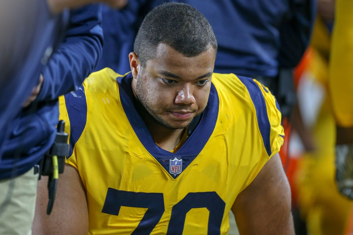 Los Angeles Rams OL Joe Noteboom rests on the sideline during the Week 11 game against the Kansas City Chiefs, Nov. 19, 2018.