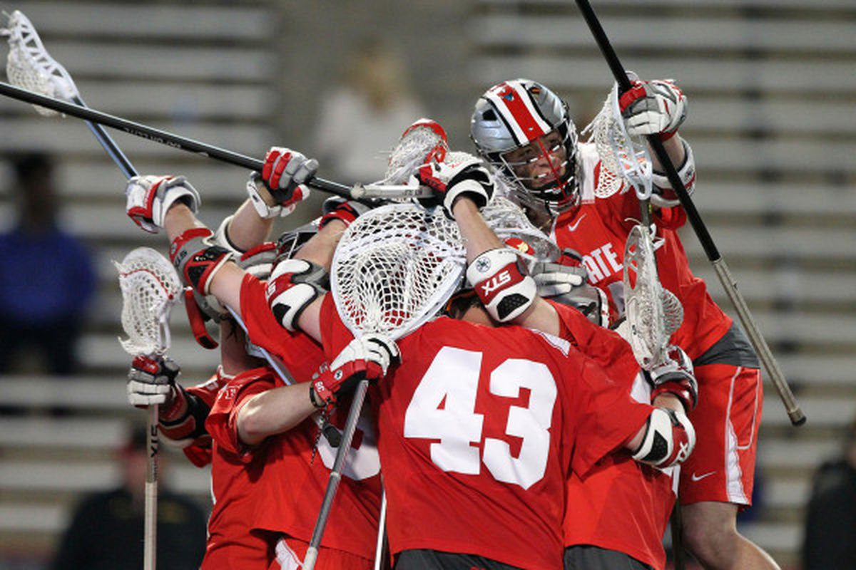 Ohio State lacrosse players celebrate during their semifinal game against Maryland in the Big Ten Tournament.