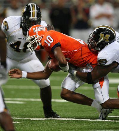 NCAA: Tigers Take Illini 40-34