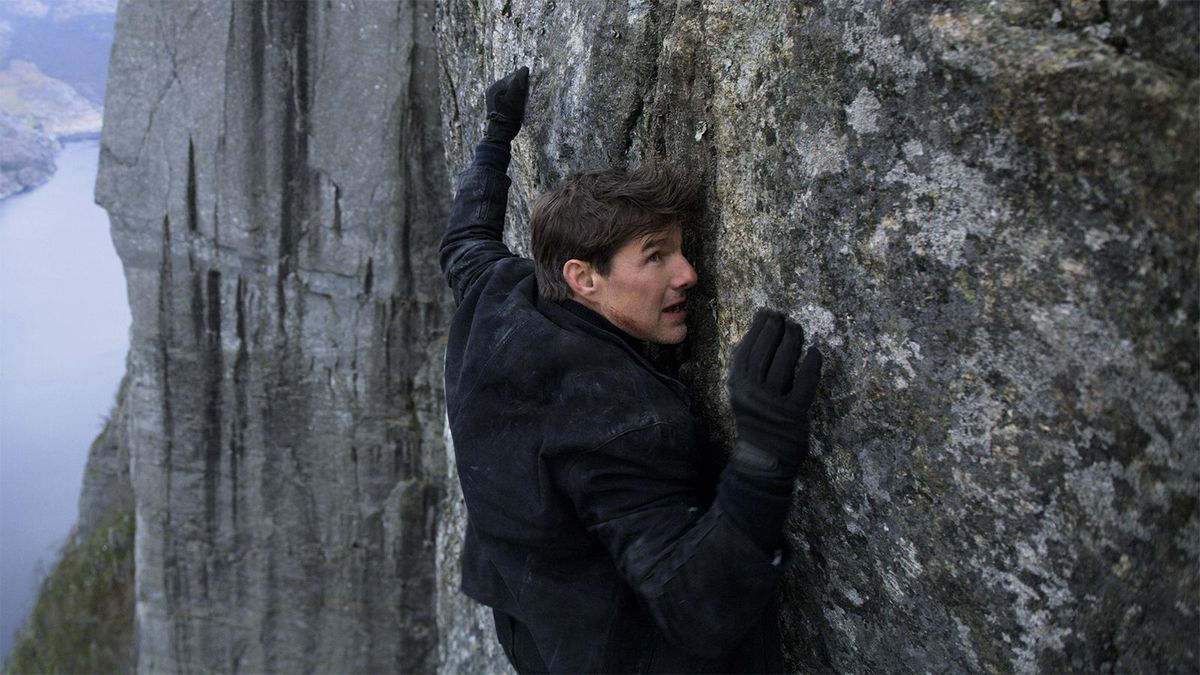 tom cruise hanging from a cliff in mission impossible fallout