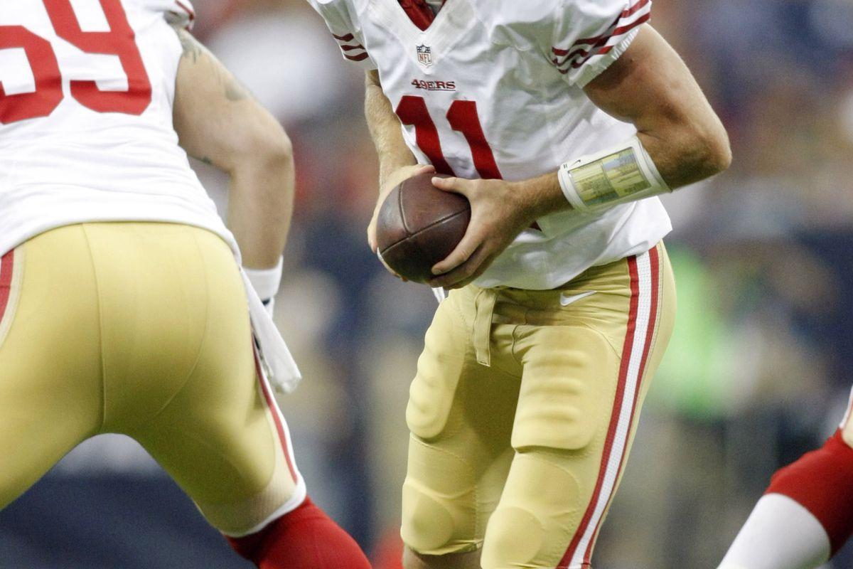 Aug 18, 2012; Houston, TX, USA; San Francisco 49ers quarterback Alex Smith (11) hands the ball off against the Houston Texans in the first quarter at Reliant Stadium. Mandatory Credit: Brett Davis-US PRESSWIRE
