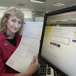 Californians now have the choice of filling out a voter registration card, like the one displayed by Secretary of State Debra Bowen, or using an online registration system that was launched Wednesday, Sept. 19, 2012,  in Sacramento, Calif.  Applicants can fill out a form online  that will be checked  against their driver's license or the state identification card held by the California Department of Motor Vehicles.