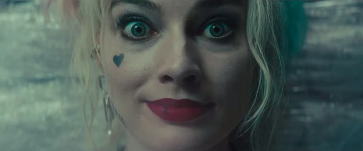 Harley Quinn smiles after getting a big whiff of cocaine in a trailer for Birds of Prey.