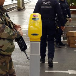 French soldiers check unattended boxes left on the platform at Gare De Lyon railway station in Paris, France, Tuesday, March 22, 2016. Authorities are tightening security at airports and on the streets of European cities after attacks on the Brussels airport and subways system that killed at least one person and injured many others.