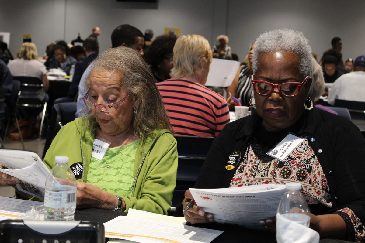 Shirley Corley and Lula Gardfrey work on the questions they planned to put to candidates for Detroit school board.