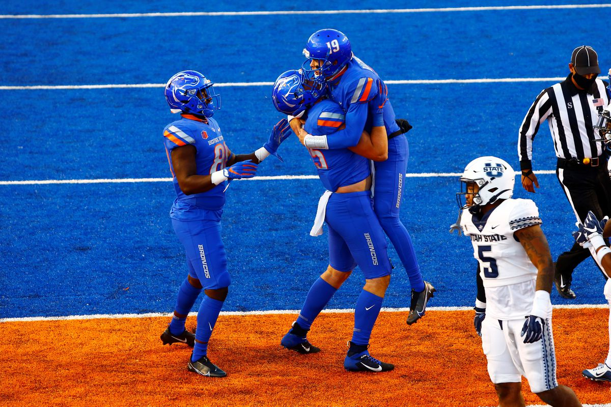 Boise State Broncos quarterback Hank Bachmeier celebrates a touchdown run with teammates during the first half versus the Utah State Aggies at Albertsons Stadium.