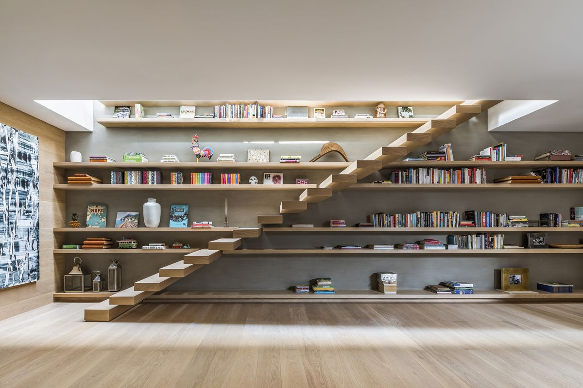 Floating timber staircase leading to upstairs.