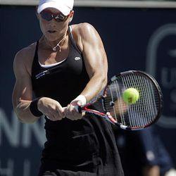 Samantha Stosur, of Australia, returns the ball to Ana Ivanovic, of Serbia.