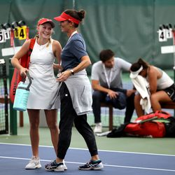 Woods Cross High School's Sage Bergeson smiles at her head coach Molly Richards after defeating Highland's Dylan Lolofie for the 5A tennis state championship at Salt Lake Tennis & Health Club on Saturday, Oct. 9, 2021.