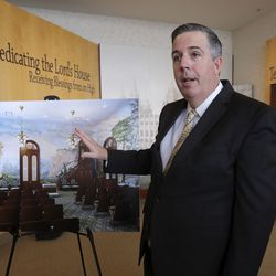 Andy Kirby, director of historic temple renovations for The Church of Jesus Christ of Latter-day Saints, shows a rendition of what the Salt Lake Temple world room will look like after future restorations, at the Temple Square South Visitors' Center in Salt Lake City, Wednesday, Dec. 4, 2019.