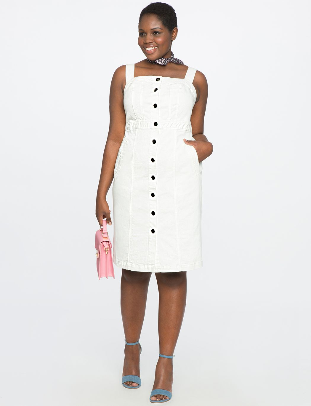 A model in a white button down dress