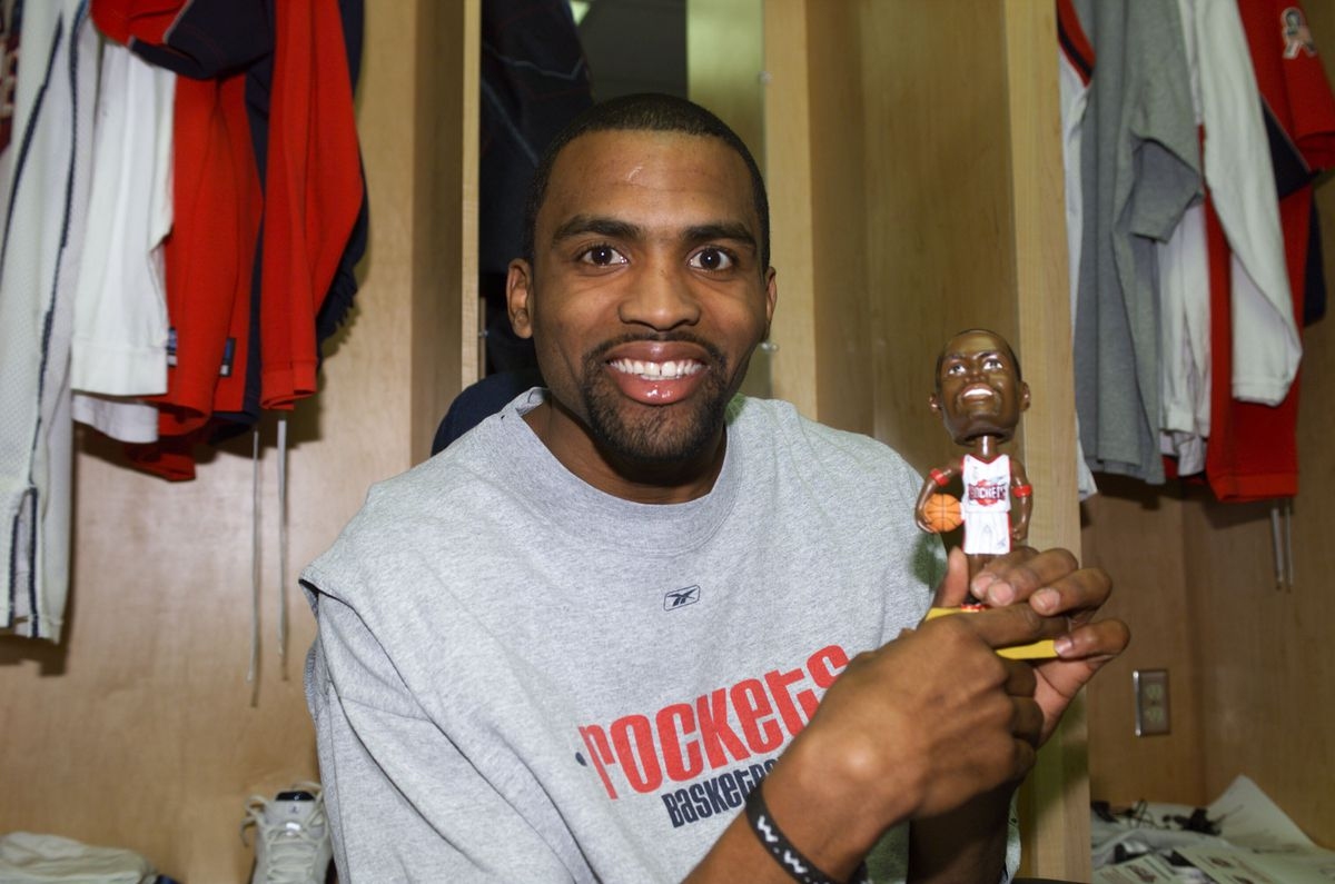 Cuttino Mobley shows off his bobble head doll.