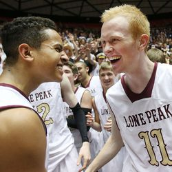 Frank Jackson and TJ Haws celebrate as Lone Peak defeats Pleasant Grove 84-66 Saturday, March 8, 2014 to claim the 5A championship in the Huntsman Center at the University of Utah.