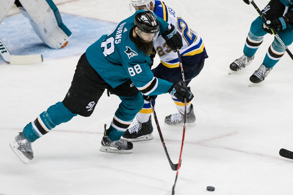 Mar 8, 2018; San Jose, CA, USA; San Jose Sharks defenseman Brent Burns (88) and St. Louis Blues right wing Dmitrij Jaskin (23) battle for control of the puck in the third period at SAP Center at San Jose