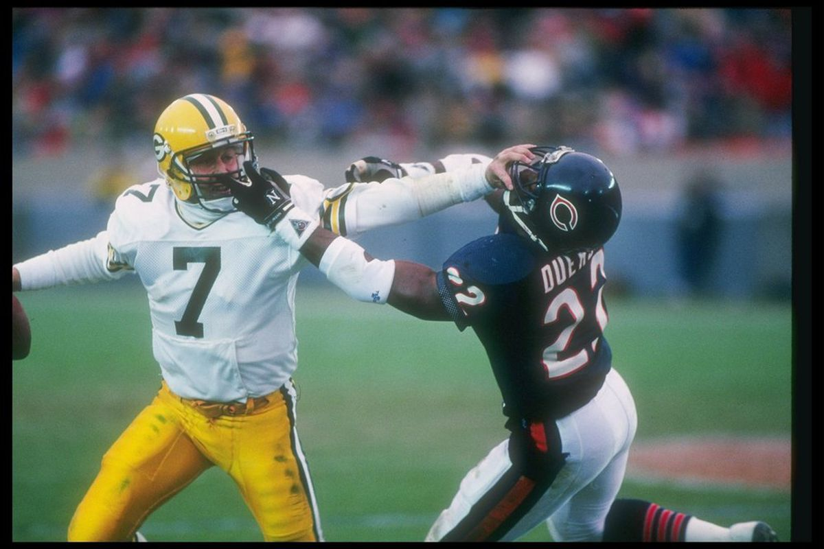 Quarterback Don Majkowski of the Green Bay Packers attempts to evade Chicago Bears defensive back Dave Duerson during a game at Soldier Field in Chicago, Illinois. The Bears won the game, 16-0. (Photo: Jonathan Daniel/Getty Images)
