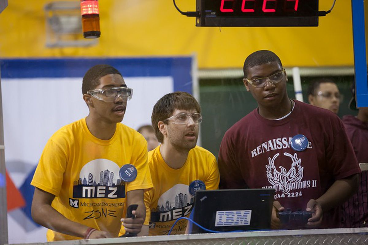 A student wearing a Renaissance High School t-shirt competes in a robotics competition.