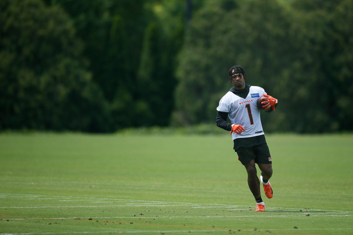 Cincinnati Bengals wide receiver Ja'Marr Chase (1) runs extra drills after practice during the first day of Cincinnati Bengals OTAs at the Paul Brown Stadium practice field in downtown Cincinnati on Tuesday, May 25, 2021.