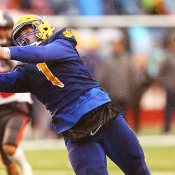 Orem's Enoch Fiso (1) makes a catch ahead of Mountain Crest's Beau Robinson (7) as Orem and Mountain Crest play for the 4A football championship at Rice Eccles Stadium at The University of Utah in Salt Lake City on Friday, Nov. 17, 2017. Orem won 26-0.