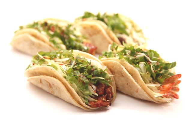 Four tacos in flour shells.