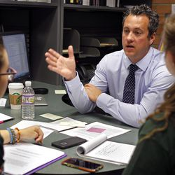 Michael Roe, principal of Poly High School, meets with students McKenna Elton, 16, left, and Deborah Platt, 15, from the Poly Social Justice Council, in Roe's office on Feb. 16, 2016, in the city of Riverside.