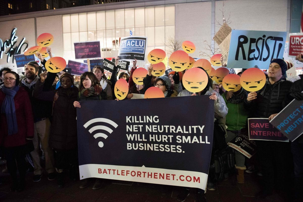 Protestors gather on Bolyston Street in front of a Verizon store during a net neutrality rally on Dec. 7, 2017, in Boston, Mass. Demonstrations in support of net neutrality are planned nation-wide at hundreds of Verizon stores and other venues. / AFP PHOT