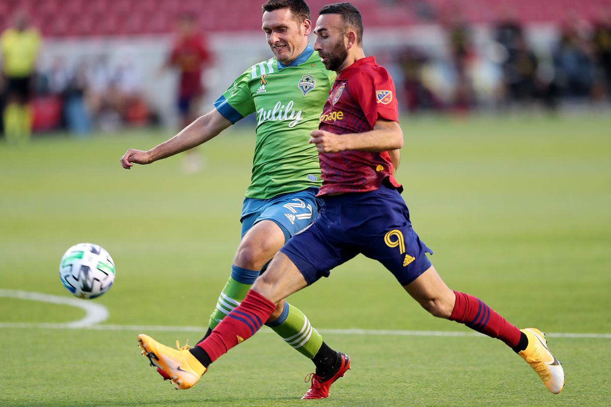 Real Salt Lake forward Justin Meram (9) tries to get a kick off ahead of Seattle Sounders defender Shane O'Neill (27) as Real Salt Lake and Seattle play an MSL soccer game at Rio Tinto Stadium in Sandy Utah on Wednesday, Sept. 2, 2020.