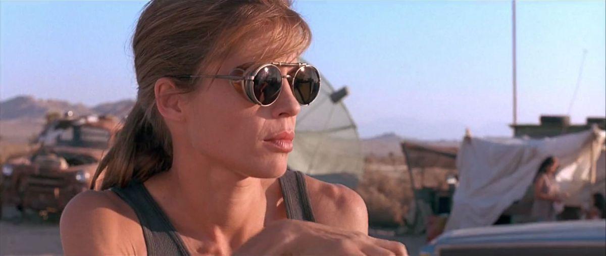 linda hamilton as sarah connor wearing sunglasses in t2