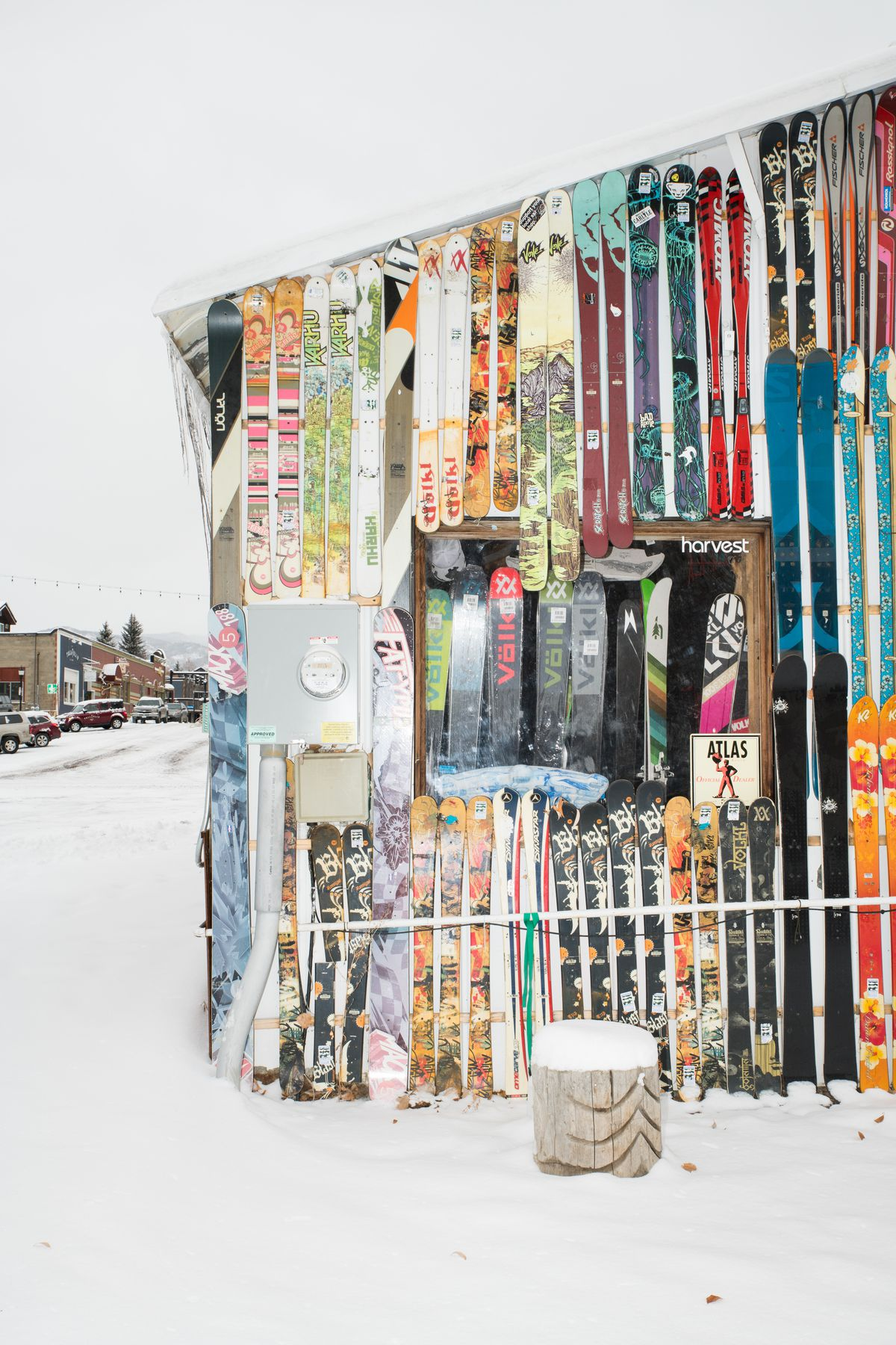 The side of a building covered in skis.