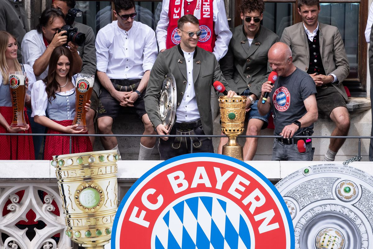 26 May 2019, Bavaria, Munich: Goalkeeper Manuel Neuer of FC Bayern Munich celebrates the German Football Championship and the DFB Cup victory on the balcony of the town hall at Marienplatz.