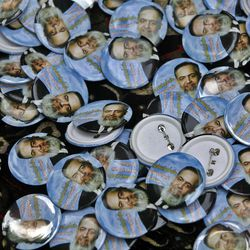 In this March 30, 2012 picture, campaign buttons with pictures of Egyptian presidential candidate Hazem Abu Ismail, a prominent Salafi, are displayed for sale in front of a mosque in Cairo, Egypt. The presidential election scheduled in May will mark the beginning of a handover of power by the ruling military to an elected civilian, following last year's popular uprising that overthrew Hosni Mubarak. (AP Photo/Amr Nabil)