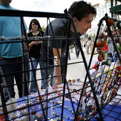 Ben Bailey checks out the display at Sophie's Beads during Craft Lake City.