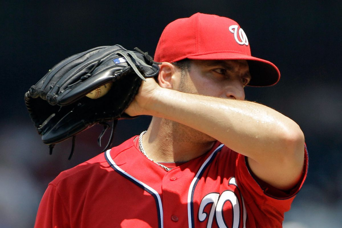 WASHINGTON, DC - JULY 03: Starting pitcher Jason Marquis #21 of the Washington Nationals reacts before pulled in the second inning against the Pittsburgh Pirates at Nationals Park on July 3, 2011 in Washington, DC.  (Photo by Rob Carr/Getty Images)