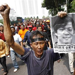 A protester chants during an anti-Internal Security Act (ISA) protest near the National Mosque in Kuala Lumpur, Malaysia, Saturday.
