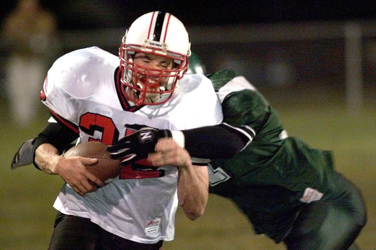 Grantsville's Alan Mouritsen rushes for a first down during his record breaking game Friday Oct. 20, 1998 against South Summit High. PHOTO BY CHUCK WING/DESERET NEWS