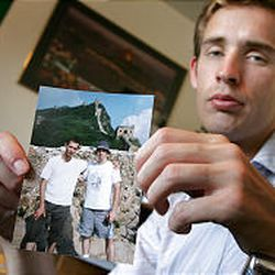 George Bailey, a BYU student who was the last of David Sneddon's acquaintances to see him, shows a photo of the two of them in China.