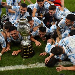 The team have a lie down with the trophy