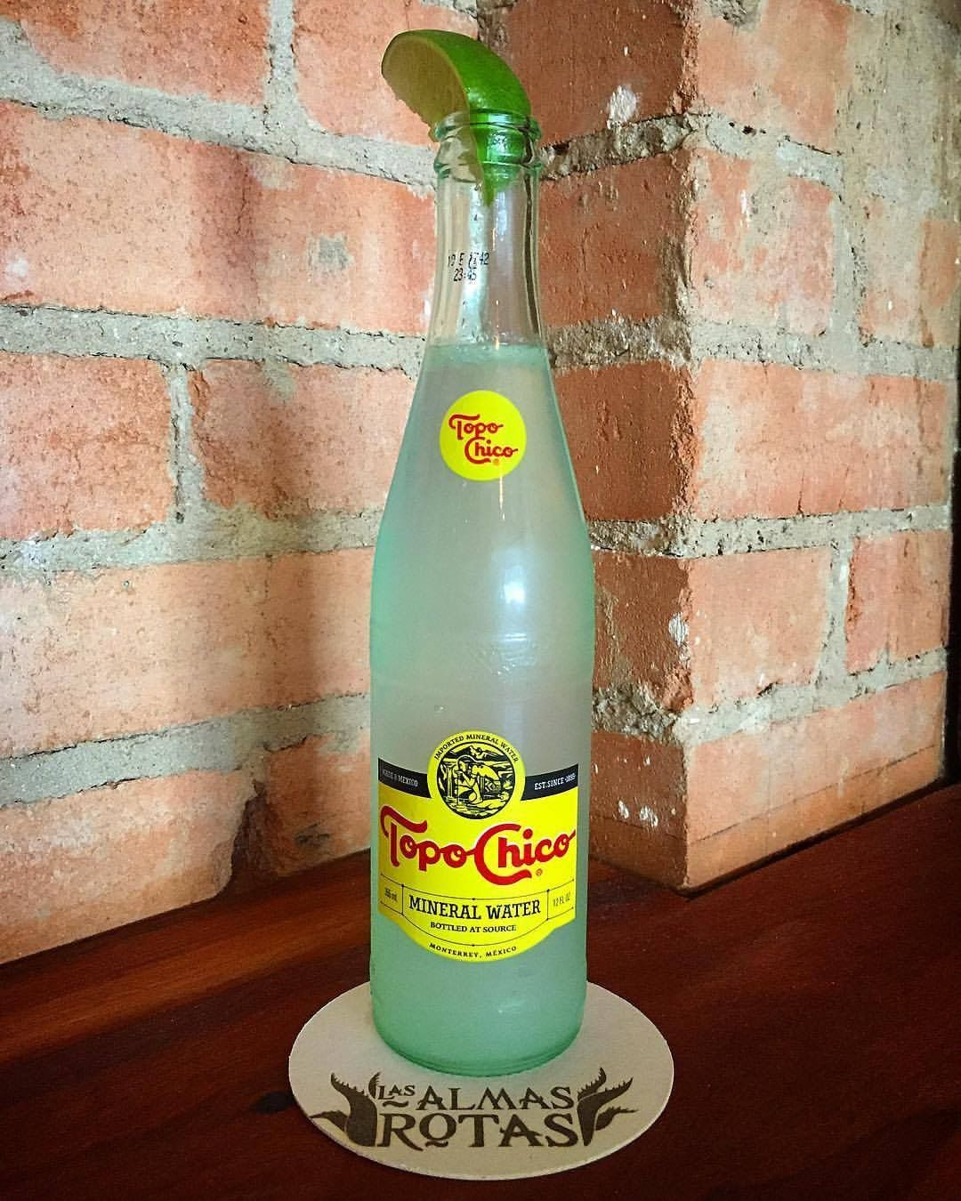 A Ranch Water cocktail served in a Topo Chico bottle