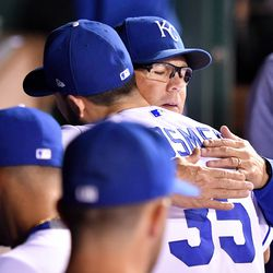 Kansas City Royals manager Ned Yost gives first baseman Eric Hosmer (35) a hug after coming out of the game in the fifth inning against the Arizona Diamondbacks at Kauffman Stadium in Kansas City, Mo., on Saturday, Sept., 30, 2017.