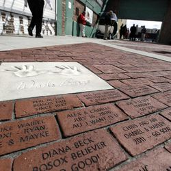 A new walkway of dedicated bricks, including the imprinted hands of former Boston Red Sox third baseman Wade Boggs, is seen at Fenway Park in Boston Monday, April 9, 2012. The Boston Red Sox baseball home opener is Friday, April 13, 2012.