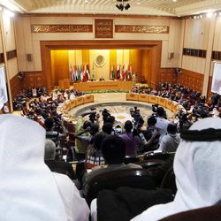 Arab delegations attend the Arab League's ministerial council meeting at the League's headquarters in Cairo, Egypt, Wednesday, Sept. 5, 2012. Egyptian President Mohammed Morsi made remarks at the opening session which began early Wednesday at the Arab League headquarters. Morsi promised that all Syrian students in Egypt will be treated the same as Egyptians rather than foreigners.  Lebanese foreign affairs minister Adnan Mansour and the chairman of the session is seen on both screens.